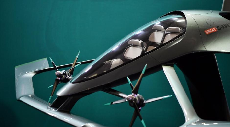 mage of a small, electrically powered, unmanned, vertical takeoff taxi plane.