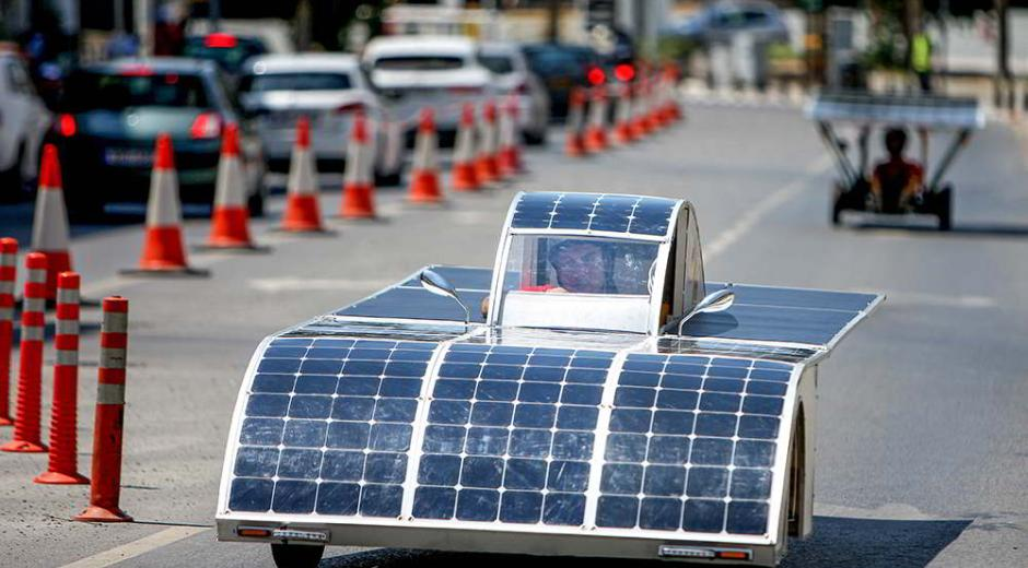 A vehicle decorated with solar panels made by hand