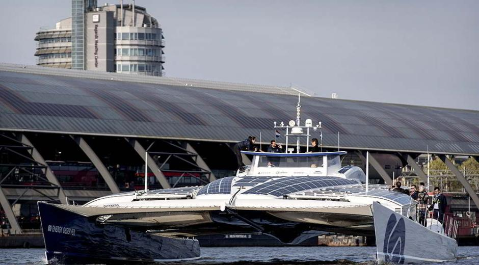 A catamaran called Energy Observer moored in the port of Amsterdam