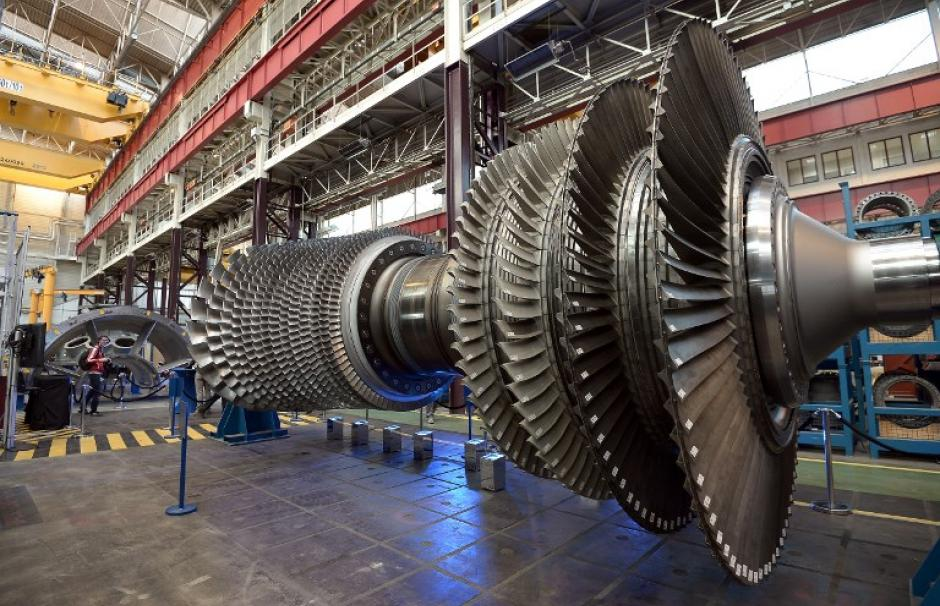 Photo of a huge General Electric gas turbine at the company's plant in Belfort, France.