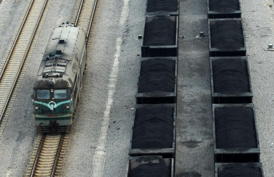 Photo of trains carrying coal in the large industrial and mining city of Hubei, China.