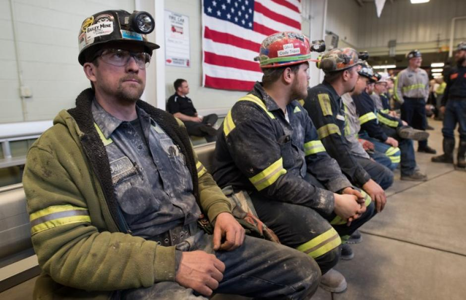 Image showing coal miners in front of an American flag at an event in support of President Donald Trump's coal policy.