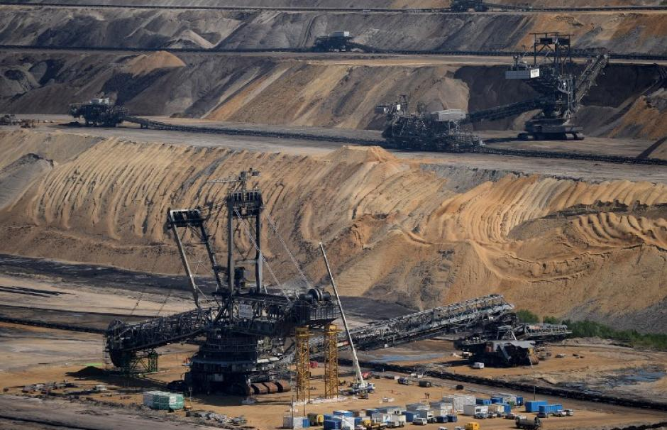 A bucket-wheel excavator extracts coal from the brown coal open cast mine Garzweiler on August 5, 2013 in Immigrath, western Germany. The small town Immerath and surrounding towns will be wiped off the map to allow energy giant RWE enlarge the huge open p