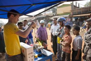 Solar lamps have revolutionized access to energy in rural areas. Here, the Awango by Total range is being demonstrated at a market in Myanmar.