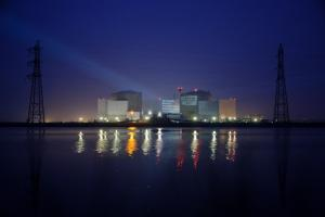 Photo of a night-time demonstration organized by Greenpeace in front of the Fessenheim nuclear power plant in Alsace.