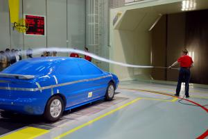 Aerodynamic testing using a smoke wand in a wind tunnel