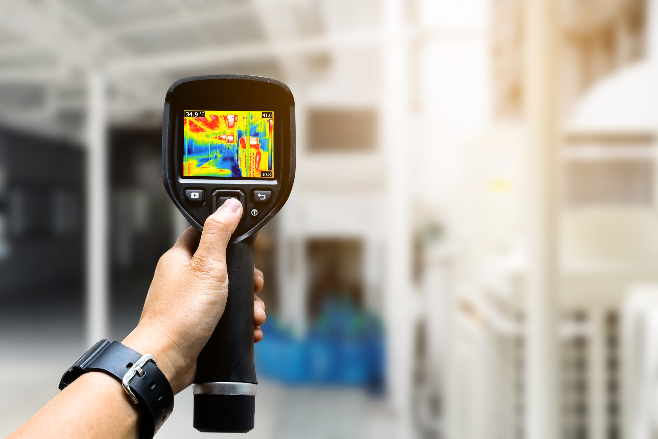 Technician using a thermal imaging camera